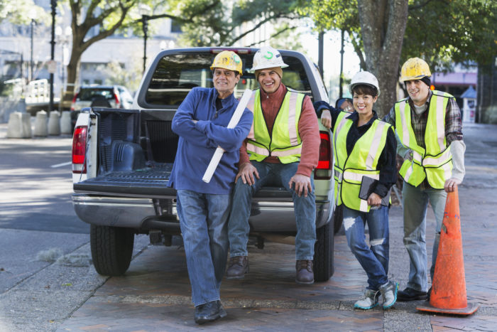 Construction workers by a pickup truck